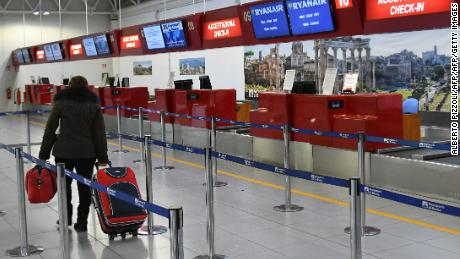 "A picture shows the check-in desk Ryanair on December 15, 2017 at Rome's Ciampino airport. Ryanair has invited pilot unions across Europe for talks on their recognition, the Irish no-frills airline said today as it faced strike action in Italy ahead of planned walkouts elsewhere. ""Christmas flights are very important to our customers and we wish to remove any worry or concern that they may be disrupted by pilot industrial action,"" Ryanair chief executive Michael O'Leary said in a statement announcing the conditional offer to pilot unions in Britain, Germany, Italy, Spain and Portugal.  / AFP PHOTO / Alberto PIZZOLI        (Photo credit should read ALBERTO PIZZOLI/AFP/Getty Images)"