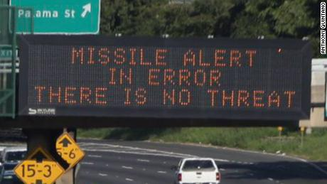 "An electronic sign reads, ""Missile alert in error. There is no threat."""