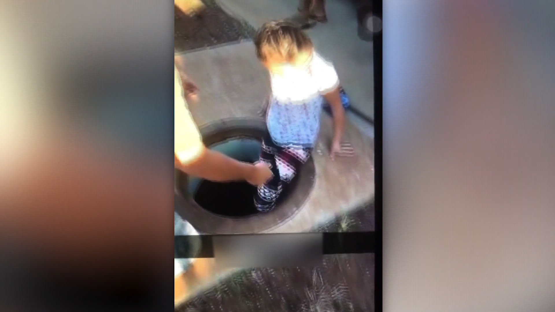 Man helps young girl into manhole in Hawaii