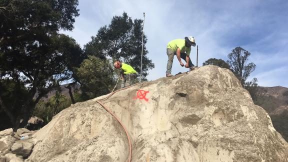 Crews working to break down boulders on January 14, 2018, in Montecito, California.