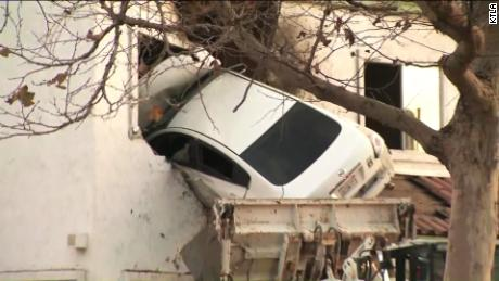 NS Slug: CA: DRIVER CAREENS INTO 2ND STORY OF BUILDING (WHOA!)  Synopsis: CA driver puts car into second floor of a building in Santa Ana.  Keywords: CALIFORNIA SANTA ANA ACCIDENT