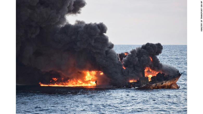 Burning oil tanker sinks