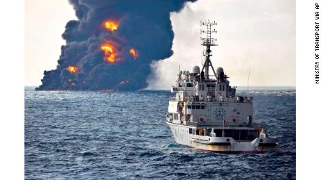 In this Sunday photo provided by China's Ministry of Transport, a rescue ship sails near the burning Iranian oil tanker Sanchi in the East China Sea.