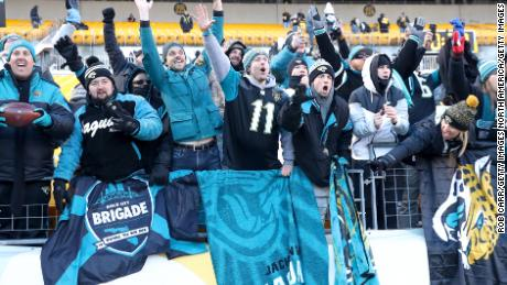 PITTSBURGH, PA - JANUARY 14:  Jacksonville Jaguars fans celebrate after defeating the Pittsburgh Steelers in the AFC Divisional Playoff game at Heinz Field on January 14, 2018 in Pittsburgh, Pennsylvania.  (Photo by Rob Carr/Getty Images)