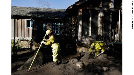 A Cal Fire search and rescue crew at a storm-damaged home in Montecito.