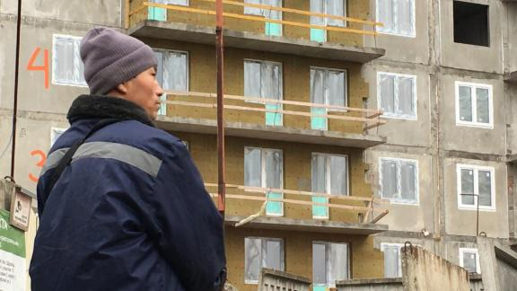 A Notrh Korean worker stands at a building site in St. Petersburg, Russia.