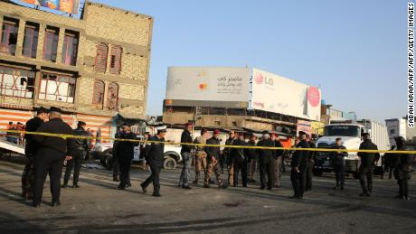 Iraqi security forces cordon off an area in central Baghdad after a deadly double suicide bombing on Monday.