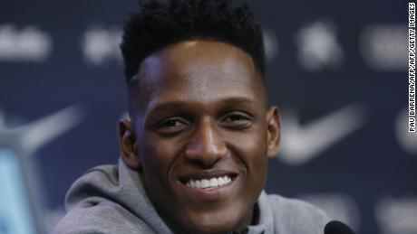 Barcelona's new Colombian defender Yerry Mina smiles during a press conference in Barcelona on January 13, 2018. / AFP PHOTO / Pau Barrena        (Photo credit should read PAU BARRENA/AFP/Getty Images)