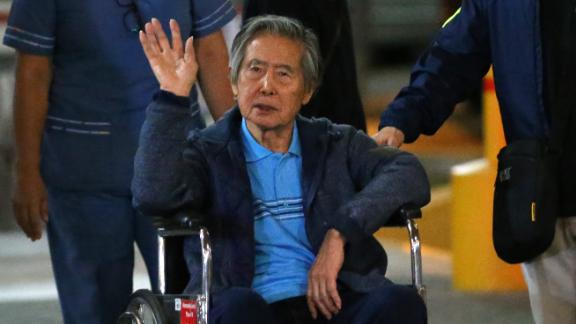 Ex-Peruvian President Alberto Fujimori is wheeled out of a Lima clinic in January after being hospitalized.