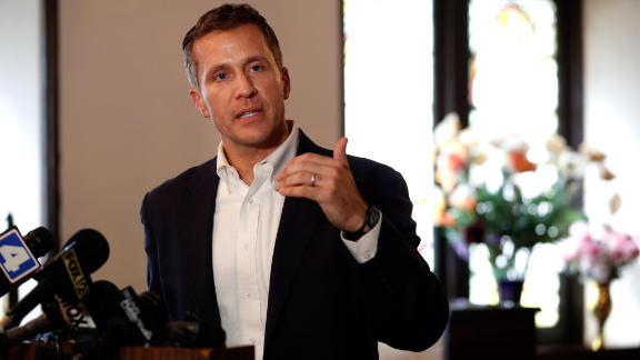 """FILE- In this Sept. 11, 2017, file photo, Missouri Gov. Eric Greitens speaks to the media after meeting with clergy at Washington Metropolitan AME Zion Church ahead of a verdict in the trial of former St. Louis police officer Jason Stockley in St. Louis. Greitens' campaign promises are being put to the test by protests that began after Stockley was acquitted in the death of a black drug suspect. As a candidate, Greitens asserted that there could have been peace """"by the second night"""" in Ferguson if the governor had exerted a commanding presence. (AP Photo/Jeff Roberson, File)"""