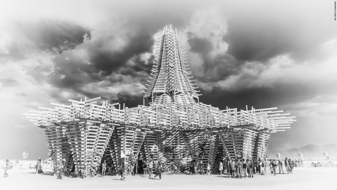 "The large timbers of <a href=""http://www.temple2017.org/"" target=""_blank"">2017's temple</a> were assembled to create a delicate, interwoven structure that was 150 feet wide. The latticed wood created patterned shadows, while the focus of the central space was a void in the spire where the sunlight shone into."