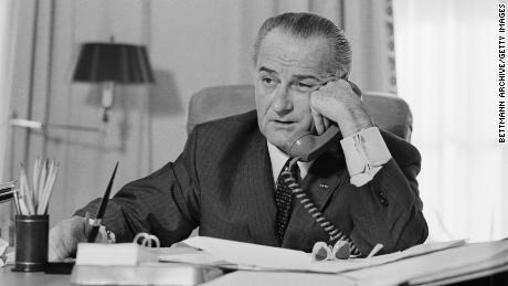 President Lyndon B. Johnson on the phone in the Oval Office in January 1968.