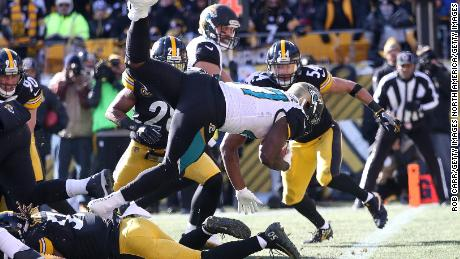 Leonard Fournette #27 of the Jacksonville Jaguars dives into the end zone for a touchdown.