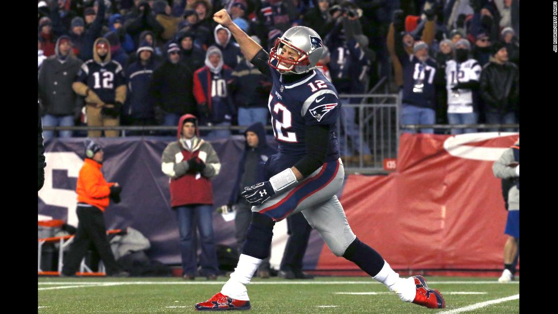 New England Patriots quarterback Tom Brady celebrates after a touchdown in the third quarter of the AFC divisional playoff game against the Tennessee Titans on Saturday, January 13, in Massachusetts. The Patriots will go on to face the Jacksonville Jaguars to vie for a spot in the Super Bowl.