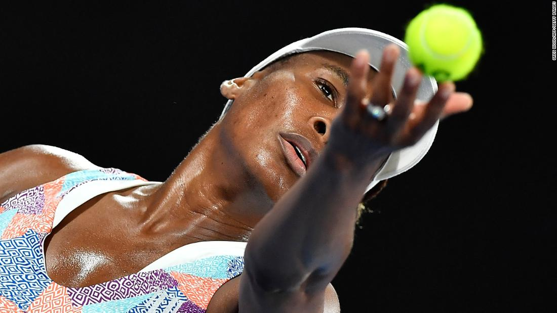 Venus Williams serves against Switzerland's Belinda Bencic during their women's singles first-round match on day one of the Australian Open in Melbourne on January 15. Bencic defeated Williams in a surprising upset. <br />