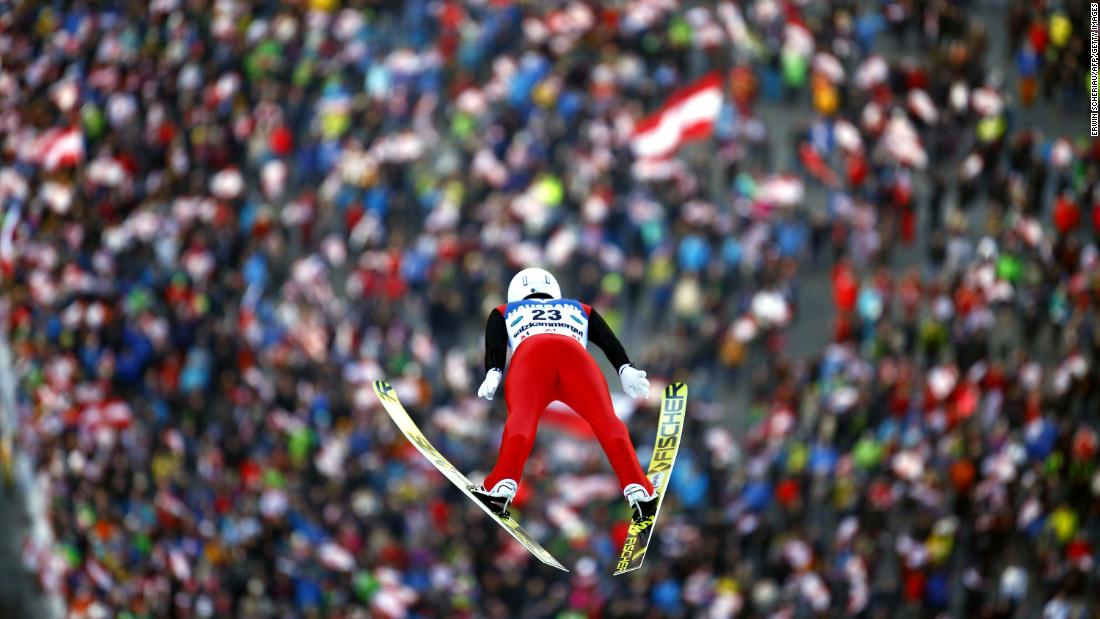 Switzerland's Simon Ammann soars through the air during the Ski Flying World Championships in Austria on January 13.