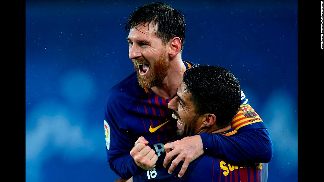Barcelona's Lionel Messi celebrates with teammate Luis Suarez after scoring his team's fourth goal during the La Liga match against Real Sociedad on January 14.