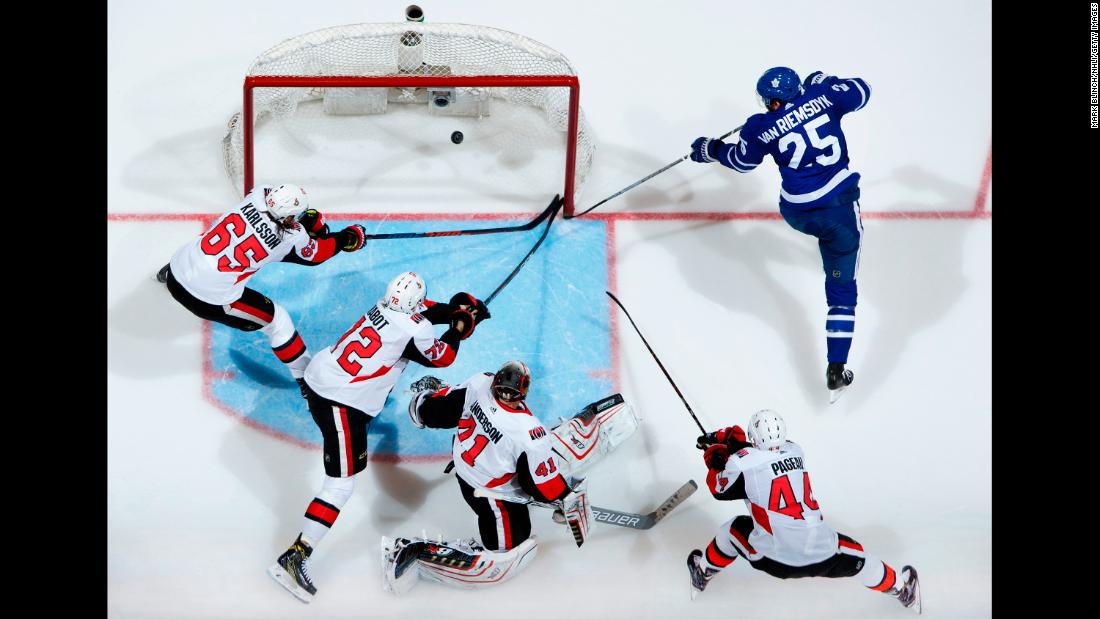 James van Riemsdyk of the Toronto Maple Leafs scores on Ottawa Senators players, from left, Erik Karlsson, Thomas Chabot, Craig Anderson, and Jean-Gabriel Pageau on January 10.  The Senators ultimately defeated the Maple Leafs 4-3.