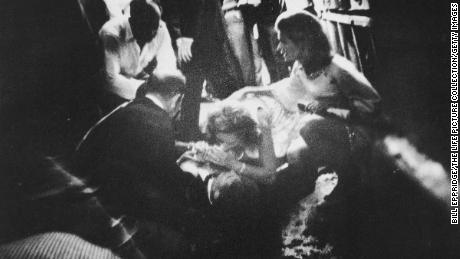 Robert F. Kennedy lies wounded on the floor of the Ambassador Hotel's kitchen while his wife Ethel leans over him on June 5, 1968, in Los Angeles.
