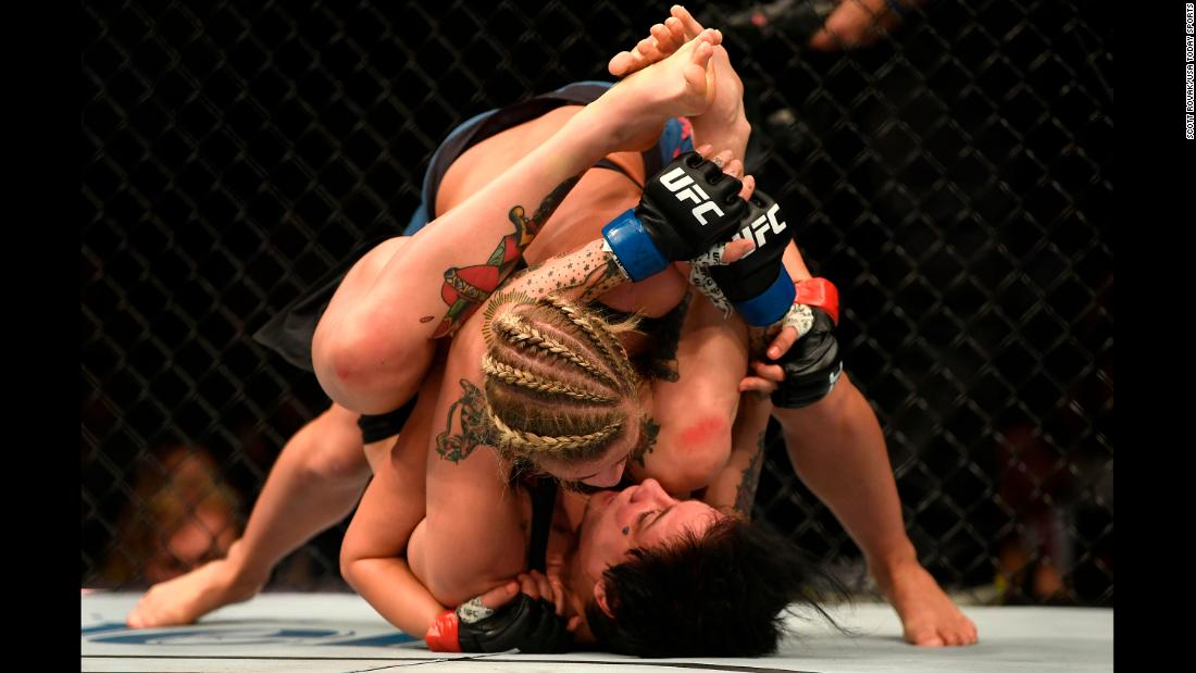 Paige VanZant (with braids) fights Jessica-Rose Clark during UFC Fight Night on January 14 in St. Louis.