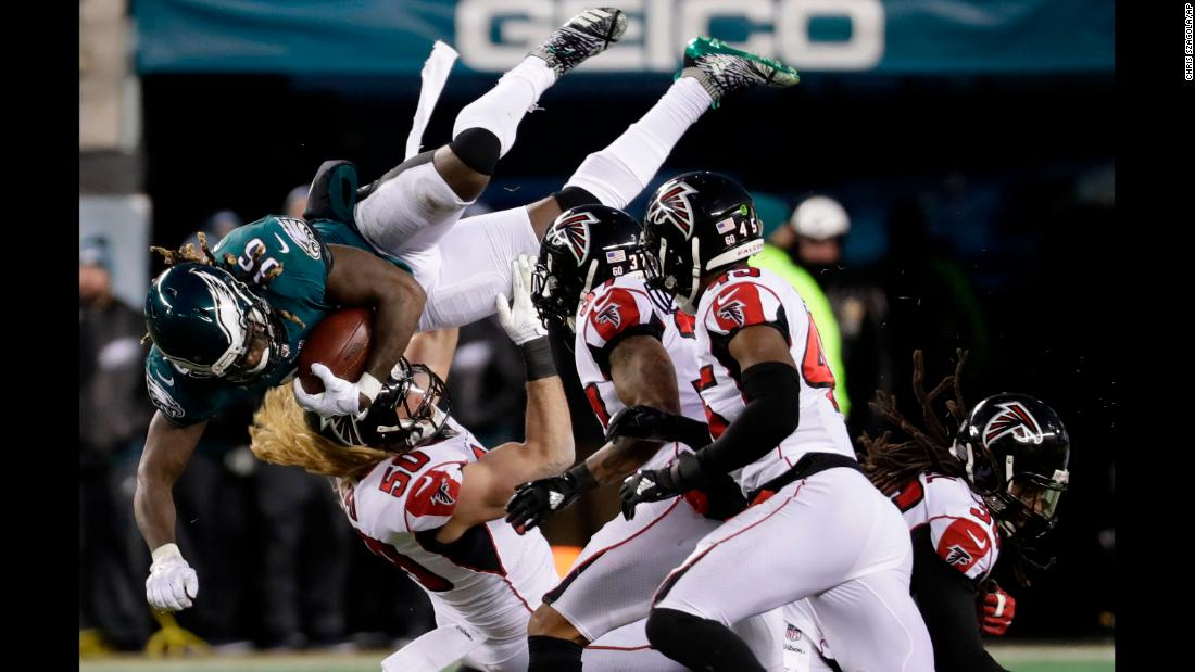 Philadelphia Eagles' Jay Ajayi is taken down by Atlanta Falcons' Brooks Reed, No. 50, during the first half of an NFL divisional playoff football game on Saturday, January 13.