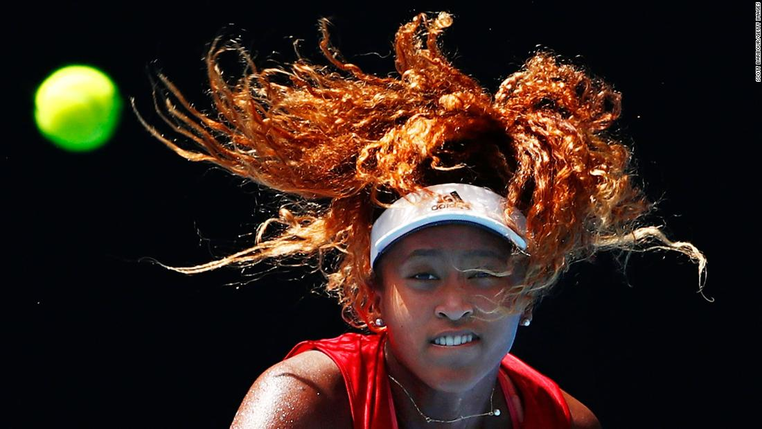 Naomi Osaka of Japan watches the ball as she serves during a practice session ahead of the 2018 Australian on Thursday, January 11.<br />