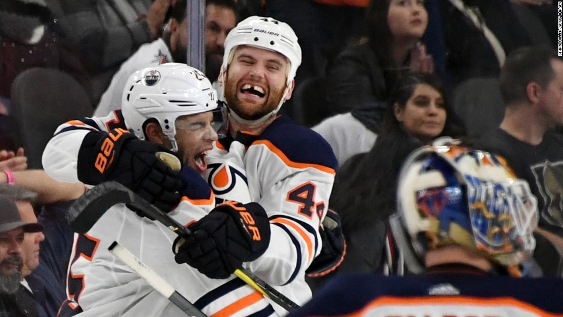 Darnell Nurse, and Zack Kassian, No. 44, of the Edmonton Oilers celebrate after Nurse scored an overtime goal against the Vegas Golden Knights to win their game 3-2 on Saturday, January 13, in Las Vegas.<br />