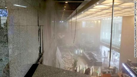 TOPSHOT - This photo received from Amailia Putri Hasniawati via WhatsApp shows dust still clouding the lobby after an internal balcony collapsed at Indonesia's stock exchange in Jakarta on January 15, 2018. A floor at Indonesia's stock exchange collapsed into the building's lobby on January 15, injuring an unknown number of people, according to media reports. / AFP PHOTO / AMAILIA PUTRI HASNIAWATI        (Photo credit should read AMAILIA PUTRI HASNIAWATI/AFP/Getty Images)