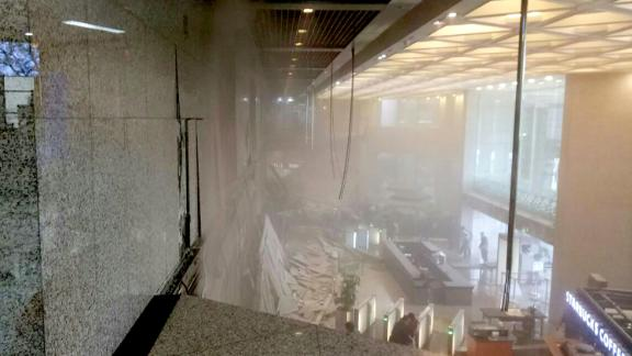 Photo shows dust still clouding the lobby after an internal balcony collapsed at Indonesia