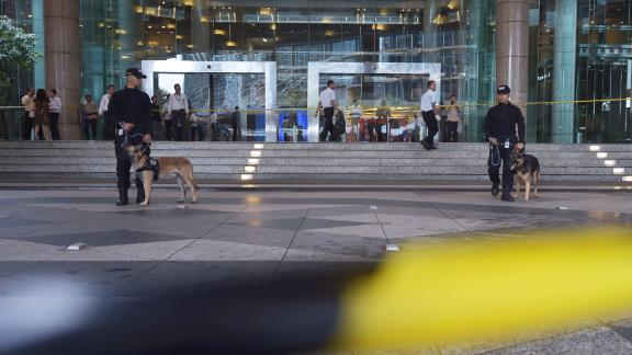 Indonesian policemen and their K9 dogs stand guard outside Jakarta