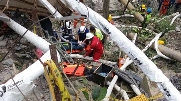 Rescue workers at the site of a collapsed bridge near Bogota, Colombia.