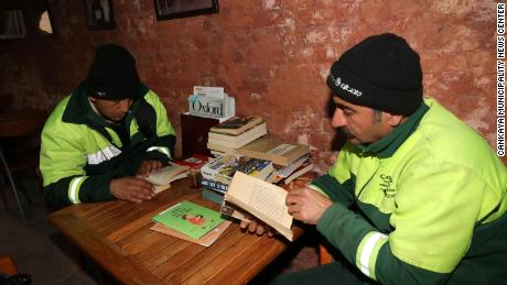 Garbage collectors in Ankara, Turkey, read books at a library that began with books that had been thrown in the trash.