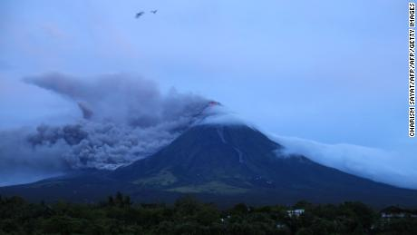 "Cloud-covered Mayon volcano spews ash as it erupts near the Philippine city of Legazpi in Albay province, early on January 16, 2018. Thousands fled from their homes as lava oozed out of a rumbling Philippine volcano on January 15 in what volcanologists described as a ""quiet eruption"", warning it could lead to a hazardous explosion within days. / AFP PHOTO / CHARISM SAYATCHARISM SAYAT/AFP/Getty Images"