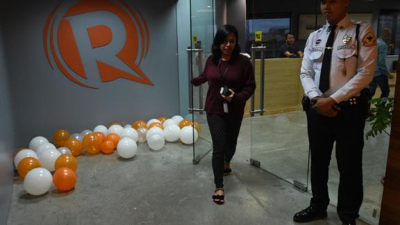 An employee of online portal Rappler heads out from their editorial office in Manila on January 15, 2018.