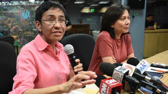 Rappler CEO and editor Maria Ressa speaks during a press conference at their office in Manila on January 15, 2018, while acting managing editor Chay Hofilena (R) listens.