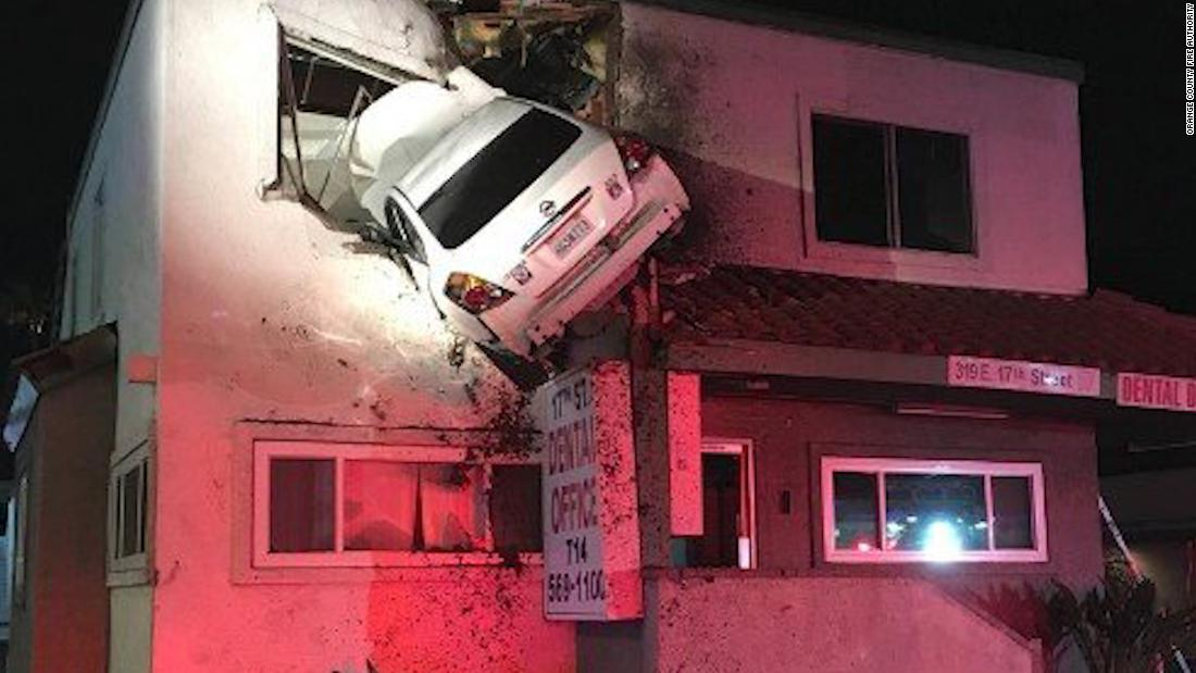 moment car crashes into second story office cnn video