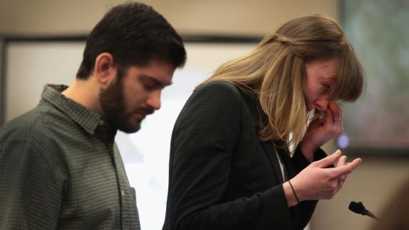 Jennifer Rood Bedford wipes a tear as she stands with her husband in court Tuesday.