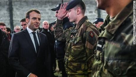 Emmanuel Macron meets security forces during his visit in the French northern city of Calais.