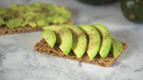 Avocado on rye crispbread is a filling breakfast.