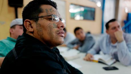 An ex-Barrio 18 gang member listens to a sermon at a church that welcomes former gang members into the congregation.
