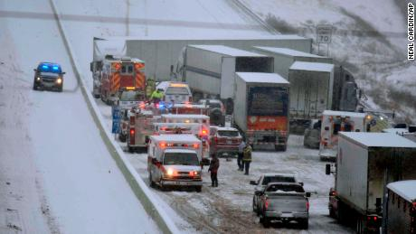 Emergency personnel remove patients for transport to area hospitals at the scene of a multi-vehicle wreck on Interstate 65 near Bonnieville, Ky., Tuesday, Jan. 16, 2018. The wreck shut down the southbound lanes for several hours. Several people were transported from the scene to at least two different hospitals.  (Neal Cardin/The News-Enterprise via AP)