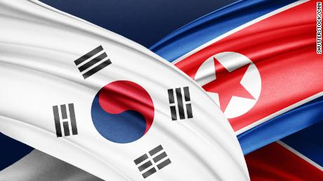 Photo illustration of North Korea and South Korea flags.