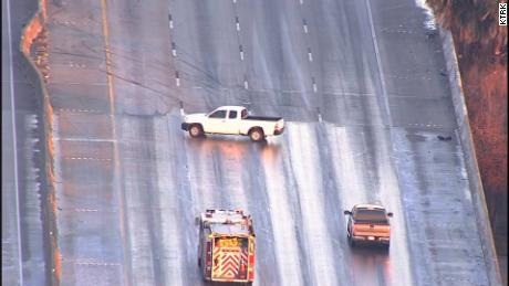 A pickup slides sideways on an icy patch Wednesday in Houston. The driver was able to regain control.