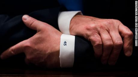 I've selected this very recent photo because I've been covering the president for the past year and I have never seen this on his shirt sleeve before.This photo was taken during a what is now called a record-breaking photo op where the White House press pool was inside the cabinet room as the president met with bipartisan members of Congress about immigration. Clearly President Trump loves and is enjoying being the 45th president of the United States and went as far as to 45 on his shirt sleeve.  President Trump makes remarks as he meets with bipartisan members of the Senate on immigration in the Cabinet Room, Jan. 9,  2018. (photo by Doug Mills The New York Times