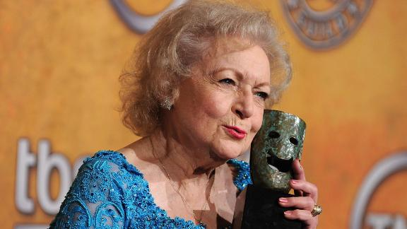 "White clutches her Life Achievement Award at the Screen Actors Guild Awards in 2010. ""I am the luckiest old broad on two feet,"" she told CNN"