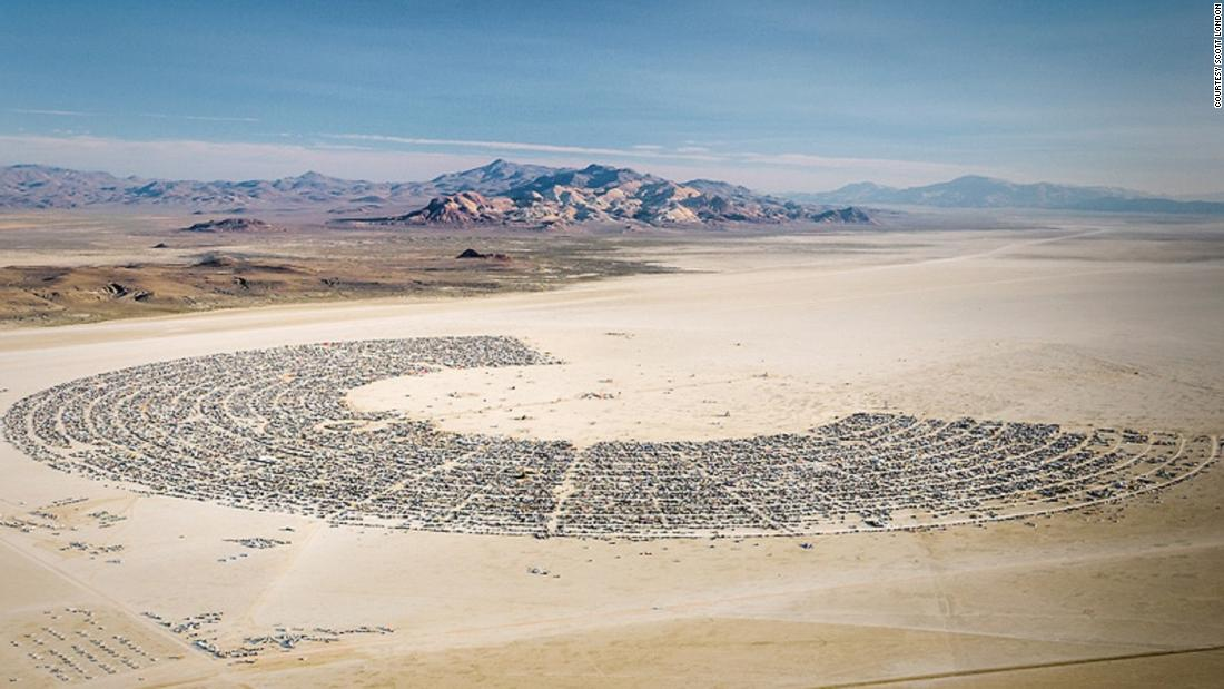 An aerial shot of Black Rock City, where Burning Man takes place each year. The horseshoe-shaped city houses over 70,000 visitors for the nine-day event. The settlements lie around the edge, the Man effigy that is burned at the end of the week stands in the center, and the temple is positioned at the opening of the semi-circle -- the last man-made structure before the expanse of desert beyond.