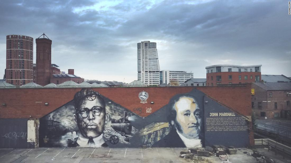 """True North,"" in Leeds, makes reference to the historical importance of mills and industry in northern England. The figure on the left is ""Jimmy Boy,"" Aylo's grandfather, who worked for years in a mill in the town of Rochdale."