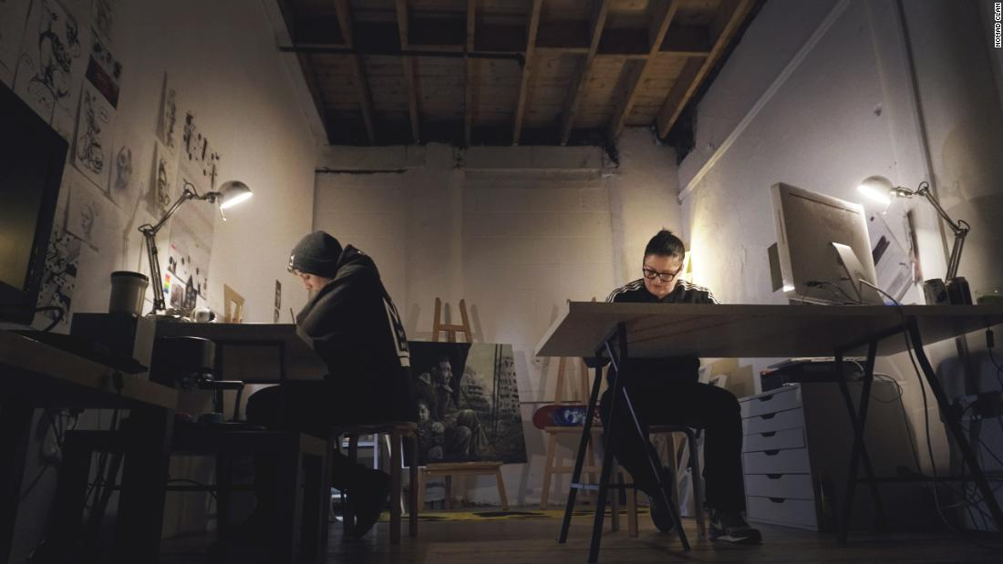 "Nomad Clan at work in their studio. ""The most intense part [of the work] is getting the sketch down and getting the sketch right, because that's the framework that you build from,"" says Arlo."