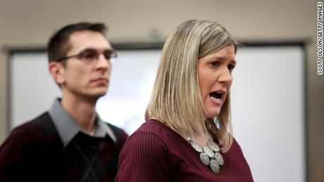 With her husband by her side, Jennifer Hayes speaks at Wednesday's sentencing hearing.