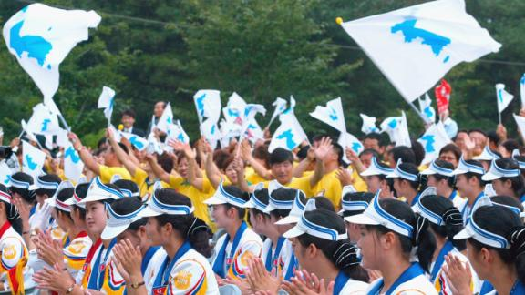 South Korean supporters wave unified flags at the World Student Games in August 2003 in Daegu, South Korea.